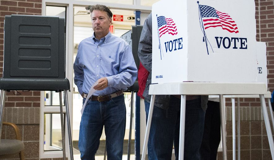 Sen. Rand Paul, R-Ky. casts his vote at Briarwood Elementary School in Bowling Green, Ky., Tuesday, Nov. 8, 2016. (AP Photo/Michael Noble Jr.)