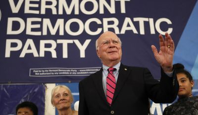Democratic Sen. Patrick Leahy acknowledges supporters after winning re-election over Republican challenger Scott Milne on Election Day, Tuesday, Nov. 8, 2016, in Burlington, Vt. (AP Photo/Robert F. Bukaty)