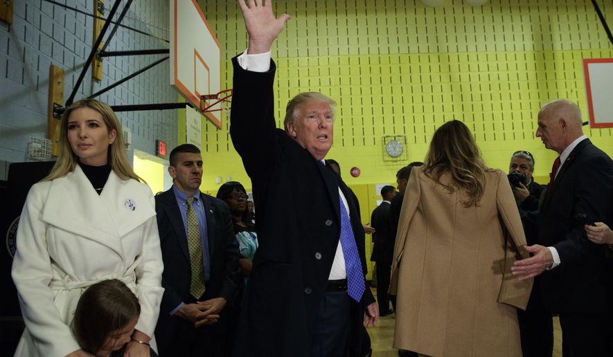 Republican presidential candidate Donald Trump waves after casting his ballot at PS-59, Tuesday, Nov. 8, 2016, in New York. (AP Photo/ Evan Vucci)