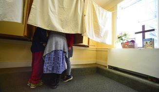 Jill Green take her two grandchildren, Lily and Caleb Groves, into the voting booth on Election Day, Tuesday, Nov. 8, 2016, Dummerston, Vt.  (Kristopher Radder /The Brattleboro Reformer via AP)