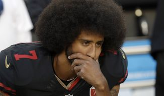 """When Eric Branch of he San Francisco Chronicle asked Colin Kaepernick whether he had voted, he replied """"no."""" When asked whether he planned to vote, he gave the same one-word reply: """"no."""" (Associated Press)"""
