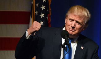 Republican presidential candidate Donald Trump pumps his fist during a campaign rally on Monday, Nov. 7, 2016, at the Lackawanna College Student Union in downtown Scranton, Pa. (Butch Comegys/The Times-Tribune via AP)
