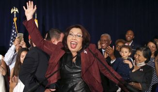Sen.-elect Tammy Duckworth, Illinois Democrat, celebrates her win over Republican incumbent Sen. Mark Kirk her election night party Tuesday in Chicago. (Associated Press)