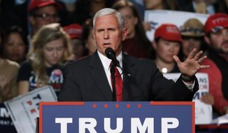 Republican vice presidential nominee, Indiana Gov. Mike Pence, speaks at a campaign rally in Grand Rapids, Mich., Tuesday, Nov. 8, 2016. (AP Photo/Paul Sancya)