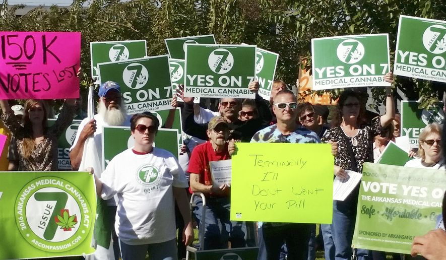 In this Oct. 28, 2016, file photo, supporters of Arkansas Issue 7, a medical marijuana initiative that would have allowed patients with certain conditions an opportunity to obtain or grow marijuana to ease their symptoms, rally outside the Arkansas Supreme Court building in Little Rock. Arkansas could become the first state in the South to legalize medical marijuana, as pot advocates look to the state in the Tuesday, Nov. 8, election to prove that support for the drug is strong even in deeply conservative states. (AP Photo/Kelly P. Kissel, File)