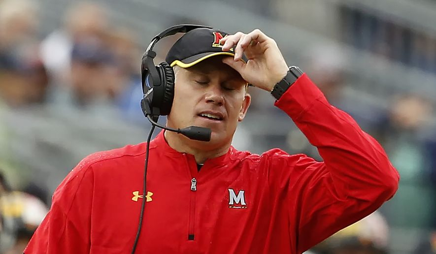 FILE - In this Oct. 8, 2016, file photo, Maryland head coach DJ Durkin reacts after Penn State scores during the second half of an NCAA college football game in State College, Pa. Durkin knew his first year at Maryland wasn't going to be easy. After absorbing a 59-3 spanking by No. 2 Michigan, the Terrapins now must prepare for sixth-ranked Ohio State. (AP Photo/Chris Knight, File)
