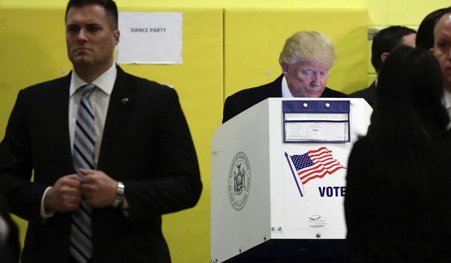Republican presidential candidate Donald Trump votes in New York, Tuesday, Nov. 8, 2016. (AP Photo/Richard Drew)