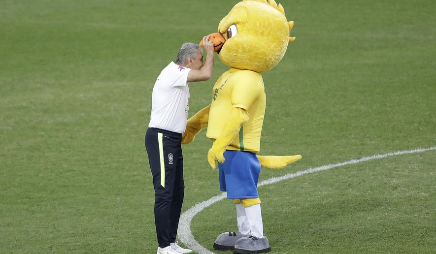 Brazil's coach Tite jokes with a mascot during a training session in Belo Horizonte, Brazil, Monday, Nov. 7, 2016. Brazil will face Argentina in a 2018 World Cup qualifying soccer match on Thursday. (AP Photo/Andre Penner)