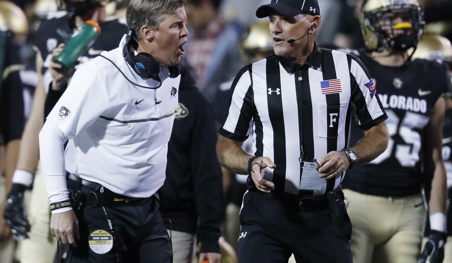 In this Thursday, Nov. 3, 2016 photo, Colorado head coach Mike MacIntyre,left, argues a personal foul call with field judge Kevin Kieser while facing UCLA in the first half of an NCAA college football game in Boulder, Colo. MacIntyre voiced his displeasure with his team after the 16th-ranked Buffaloes were penalized 12 times against UCLA, including eight personal fouls. (AP Photo/David Zalubowski)