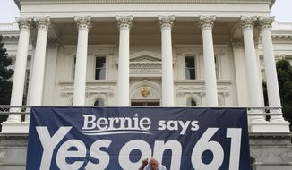 Former presidential candidate Sen. Bernie Sanders, of Vermont, speaks in support of Proposition 61 in Sacramento, Calif., Monday, Nov. 7, 2016. Proposition 61, if approved by voters Tuesday, would prohibit state agencies from paying more for prescription drugs than the U.S. Dept. of Veterans Affairs. (AP Photo/Rich Pedroncelli)