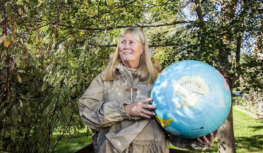 In this Thursday Oct. 13, 2016 photo, Betty Trummel poses for a portrait  showing Antarctica on a globe in Crystal Lake, Ill. Trummel, a former elementary school teacher, will travel to Antarctica in December for three weeks. She's one of 78 women chosen from around the world to participate in Homeward Bound, an education and research expedition. This will be her fourth time visiting Antarctica. (Sarah Nader/Northwest Herald via AP)
