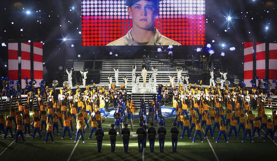 """This image released by Sony Pictures shows Joe Alwyn, portraying Billy Lynn, on a screen in a scene from the film, """"Billy Lynn's Long Halftime Walk,"""" in theaters on November 11. (Mary Cybulski/Sony-TriStar Pictures via AP)"""
