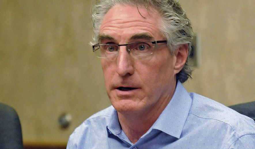 FILE - In this May 10, 2016, file photo, North Dakota Republican gubernatorial candidate Doug Burgum speaks during an editorial board meeting in Bismarck. Burgum faces Democratic state Rep. Marvin Nelson in the Nov. 8 general election. (Tom Stromme/The Bismarck Tribune via AP, File)