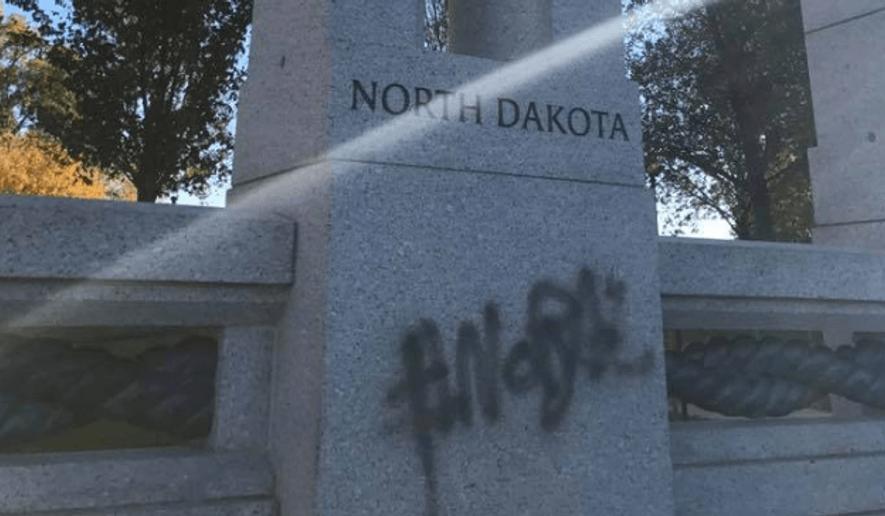 Graffiti on the North Dakota portion of the World War II Memorial in Washington D.C. (Facebook via sayanythingblog.com)