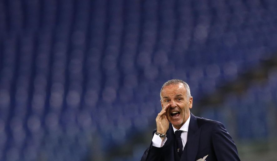 FILE -  In this Thursday, Oct. 1, 2015 file photo, Lazio coach Stefano Pioli gives indications to his players during an Europa League Group C soccer match between Lazio and Saint-Etienne, at Rome's Olympic stadium. According to reports Monday, Nov. 7, 2016, former Lazio coach Pioli is expected to be named as Inter Milan's new coach, replacing Frank de Boer who was fired last week.  (AP Photo/Riccardo De Luca, file)