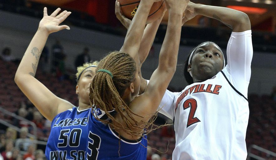 Louisville's Myisha Hines-Allen (2) attempts a shot through the defense of Lindsey Wilson's J'Nayah Hall (3) and Michelle Montgomery (50) during an NCAA college basketball exhibition game, Sunday, Nov. 6, 2016 in Louisville Ky. (AP Photo/Timothy D. Easley)
