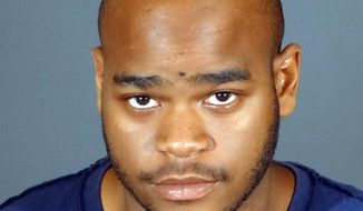 This undated photo provided by the Long Beach Police shows Brandon Colbert, of Tulsa, Okla. Colbert has been charged with two counts of murder in the Aug. 6, 2016, shooting deaths of 26-year-old Carina Mancera and her daughter Jennabel Anaya in Long Beach, Calif. (Long Beach Police via AP)