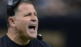 FILE - In this Dec. 29, 2013, file photo, then-Tampa Bay Buccaneers head coach Greg Schiano reacts on the sideline in the first half of an NFL football game against the New Orleans Saints, in New Orleans. Schiano is three quarters of the way through his first college football season as an assistant coach since 2000.  (AP Photo/Bill Feig, File)