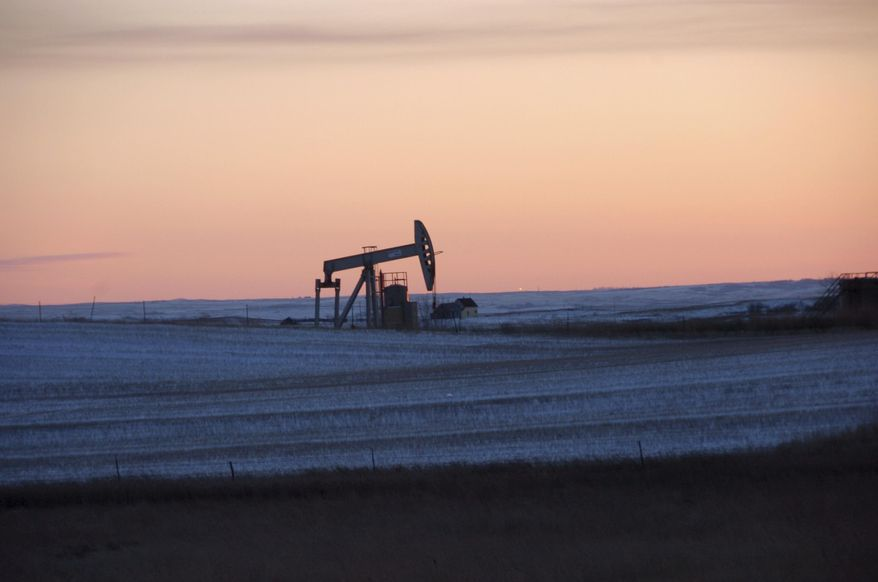 A pump jack for pulling oil from the ground is seen here near New Town, N.D., on Feb. 25, 2015. (Associated Press) **FILE**