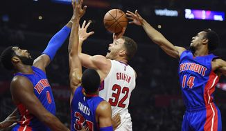 Los Angeles Clippers forward Blake Griffin, second from right, shoots as Detroit Pistons center Andre Drummond, left, forward Tobias Harris, second from left, and guard Ish Smith defend during the first half of an NBA basketball game, Monday, Nov. 7, 2016, in Los Angeles. (AP Photo/Mark J. Terrill)