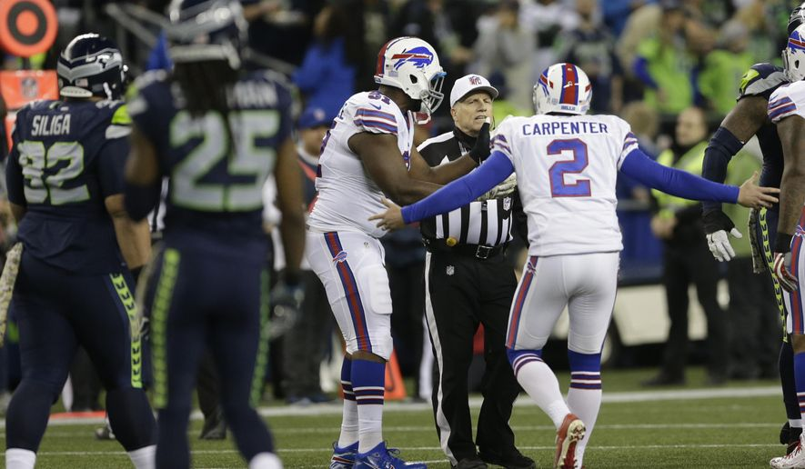 FILE - In this Monday, Nov. 7, 2016, file photo, Buffalo Bills kicker Dan Carpenter (2) complains to referee Walt Anderson late in the first half of an NFL football game against the Seattle Seahawks, in Seattle. Richard Sherman spent last week criticizing what he believed were incorrect calls, only to be at the center of another officiating flap Monday night that this time went Seattle's way. (AP Photo/John Froschauer, File)