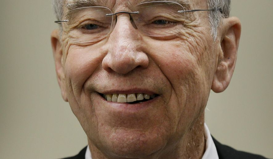 FILE - In this March 28, 2016 file photo, incumbent U.S. Sen. Chuck Grassley, R-Iowa, speaks during a town hall meeting at the Ocheyedan Senior Center in Ocheyedan, Iowa. Grassley faces Democrat, former Iowa Lt. Gov. Patty Judge, in the Nov. 8 election. (AP Photo/Charlie Neibergall, File)
