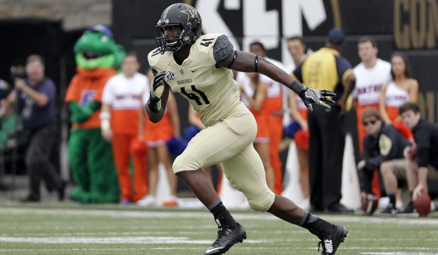FILE --In this Oct. 1, 2016, file photo, Vanderbilt linebacker Zach Cunningham plays against Florida in an NCAA college football game in Nashville, Tenn. Cunningham is making his case for Southeastern Conference defensive player of the year with one remarkable play after another. The Vanderbilt linebacker made the game-saving stop on fourth-and-1 last month and hurdled the line to block a field goal last week at Auburn. (AP Photo/Mark Humphrey, File)