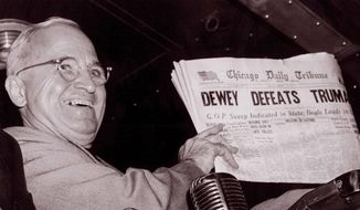 "U.S. President Harry S. Truman holds up an Election Day edition of the Chicago Daily Tribune, which mistakenly announced ""Dewey Defeats Truman"" on Nov. 4, 1948.   Associated Press photo"