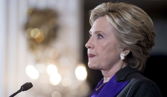 Hillary Clinton pauses while speaking in New York, Wednesday, Nov. 9, 2016, where she conceded her defeat to Republican Donald Trump after the hard-fought presidential election.  (AP Photo/Andrew Harnik)