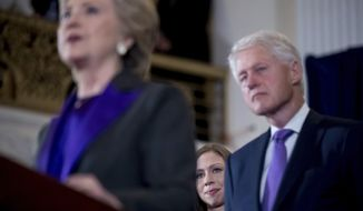 Democratic presidential candidate Hillary Clinton, left, accompanied by her husband former President Bill Clinton, right, and her daughter Chelsea Clinton, center, speaks in New York, Wednesday, Nov. 9, 2016, where she conceded her defeat to Republican Donald Trump after the hard-fought presidential election.  (AP Photo/Andrew Harnik)