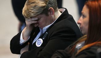 Hillary Clinton supporters react as results come in at an election night party for the Democratic presidential candidate at the Jacob K. Javits Convention Center in New York, late on Tuesday, Nov. 8, 2016.   (Vernon Bryant/The Dallas Morning News via AP)