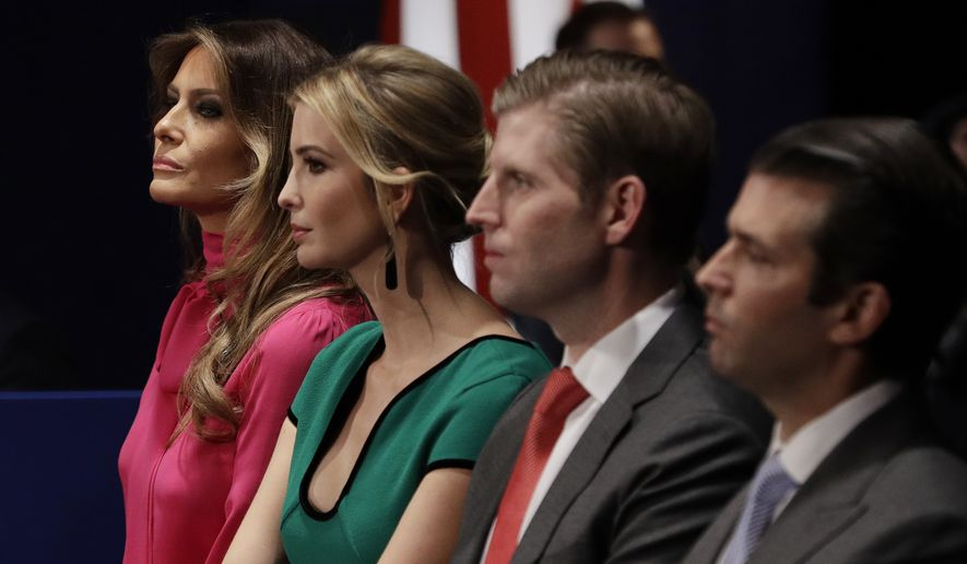 FILE - In this Sunday, Oct. 9, 2016 file photo, from left, Melania Trump, Ivanka Trump, Eric Trump and Donald Trump, Jr. wait for the second presidential debate between Republican presidential nominee Donald Trump and Democratic presidential nominee Hillary Clinton at Washington University in St. Louis. (AP Photo/John Locher)