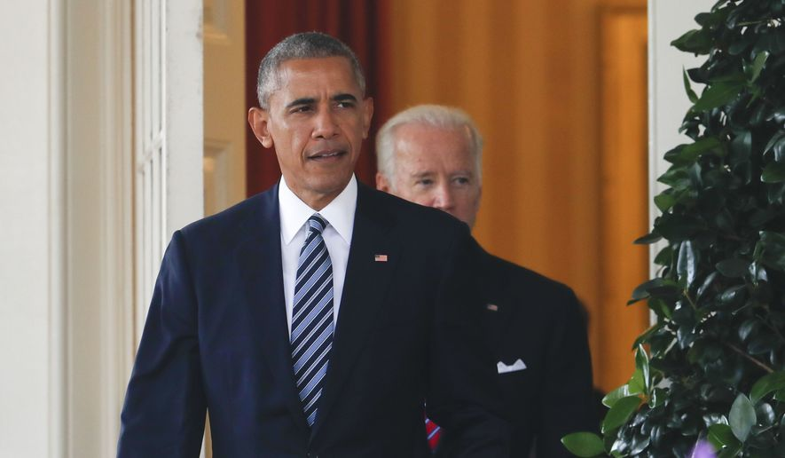 President Barack Obama, followed by Vice President Joe Biden, walks out of the Oval Office to the Rose Garden of White House in Washington, Wednesday, Nov. 9, 2016, to speak about the election.  (AP Photo/Pablo Martinez Monsivais)