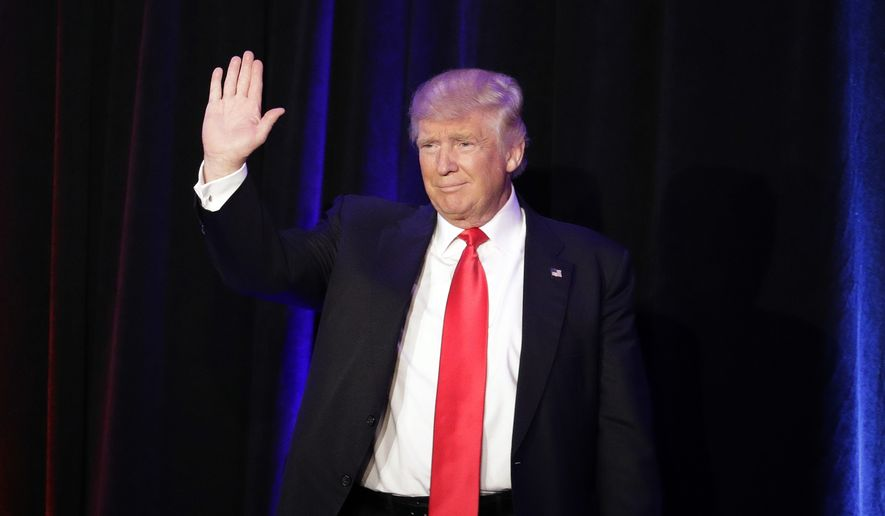 President-elect Donald Trump waves as he arrives at his election night rally, Wednesday, Nov. 9, 2016, in New York. (AP Photo/John Locher)