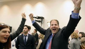 Republican Chris Sununu cheers as early results show him in the lead over Democrat Colin Van Ostern in the race for New Hampshire's governor Tuesday, Nov. 8, 2016, in Concord, N.H. (AP Photo/Jim Cole)