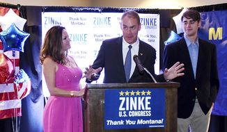 Lola and Wolfgang Zinke flank U.S. Rep. Ryan Zinke as he announces he has won a second term as Montana's voice in the House of Representatives at the Ryan Zinke Election Headquarters at the Lodge at Whitefish Lake, Tuesday, Nov. 8, 2016, in Whitefish, Mont. Zinke defeated Democratic challenger Denise Juneau. (Brenda Ahearn/The Daily Inter Lake via AP)
