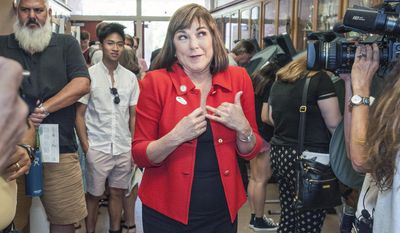 Rep. Loretta Sanchez, D-Orange, a Democratic candidate for U.S Senate. reacts to a comment about her blazer moments after voting on Election Day, Tuesday afternoon, Nov. 8, 2016,  at Orange High School in Orange, Calif. (Mark Rightmire/The Orange County Register via AP)