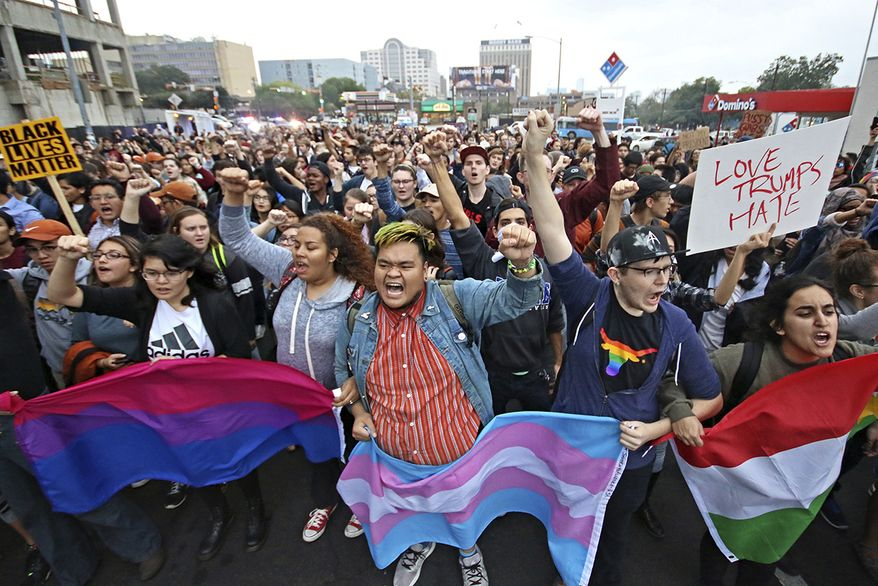 Students at the University of Texas at Austin lead a protest down to Congress Bridge Wednesday, Nov. 9, 2016, in Austin, Texas. Hundreds of University of Texas students march through downtown Austin in protest of Donald Trump's presidential victory. (Joshua Guerra/The Daily Texan via AP)