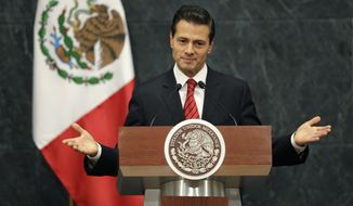 Mexico's President Enrique Pena Nieto gives an address in response to the U.S. presidential election in Mexico City, Wednesday, Nov. 9, 2016. The Mexican president said in a brief televised address that he has spoken with U.S. President-elect Donald Trump to congratulate him and his family. He said they agreed to meet during the transition period to discuss the U.S.-Mexico relationship. (AP Photo/Rebecca Blackwell)