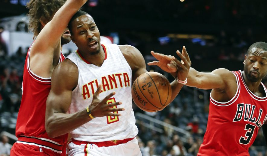 Atlanta Hawks center Dwight Howard (8) works against Chicago Bulls guard Dwyane Wade (3) and center Robin Lopez for the ball during the first half of an NBA basketball game Wednesday, Nov. 9, 2016, in Atlanta. (AP Photo/John Bazemore)