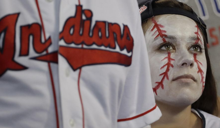 FILE - In this Nov. 1, 2016, file photo, a Cleveland Indians fan reacts during the sixth inning of Game 6 of the Major League Baseball World Series against the Chicago Cubs in Cleveland. The Indians went on to lose the Series in seven games. ESPN and The Huffington Post report on Nov. 9, 2016, that Major League Baseball is asking retailers to give back Indians championship gear so it can be destroyed. (AP Photo/David J. Phillip, File)