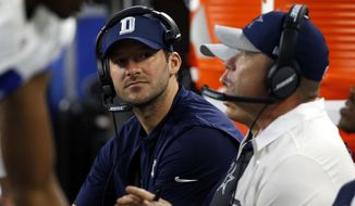 FILE - In this Oct. 30, 2016, file photo, Dallas Cowboys quarterback Tony Romo talks with coaches on the bench during an NFL football game against the Philadelphia Eagles in Arlington, Texas.  Romo is running the scout team in practice even though Dallas' starting quarterback the past 10 years looks ready to return from a back injury.(AP Photo/Michael Ainsworth, File)