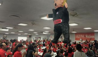 Members of the Culinary Workers Union Local 226, cheer during a rally under a Donald Trump pinata in Las Vegas on Monday, Nov. 7, 2016. Voters in swing state Nevada will play an outsized role on Tuesday when they decide whether Hillary Clinton or Donald Trump should get their six coveted electoral votes. The state also has seen a high number of Latinos vote early where Democrat Catherine Cortez Masto is trying to become the nation's first Latina senator. (AP Photo/Russell Contreras)