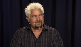 This Oct. 11, 2016 image taken from video shows celebrity chef Guy Fieri during an interview in New York. (AP Photo/Bruce Barton)