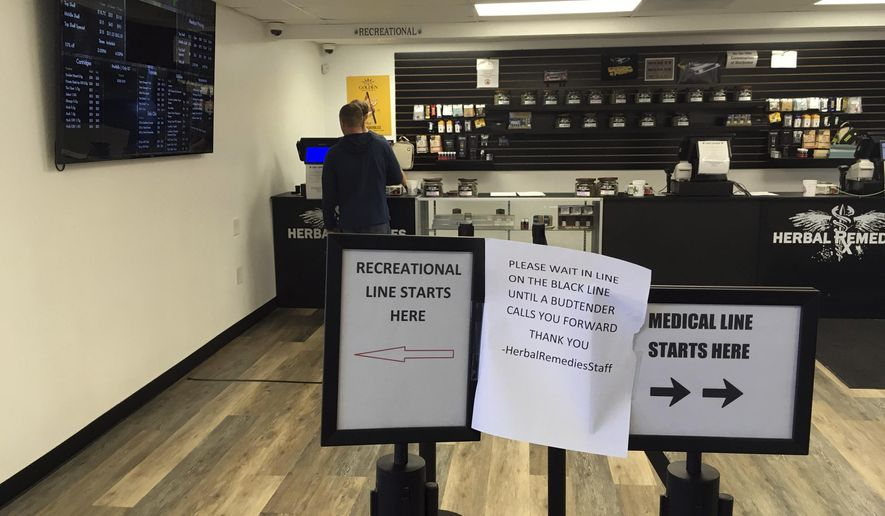 A customer is attended to inside the Herbal Remedies cannabis store Wednesday Nov. 9, 2016, just outside the Salem, Ore., city line in Marion County. Voters on Tuesday in a county-wide ballot decided to prohibit both retail and medical marijuana businesses in unincorporated parts of the county, putting the future existence of this shop in jeopardy. (AP Photo/Andrew Selsky)