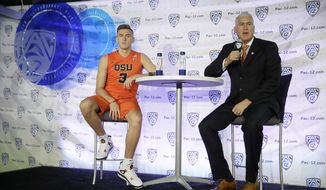 FILE - In this Oct. 21, 2016, file photo, Oregon State forward Tres Tinkle, left, and his father, head coach Wayne Tinkle answer questions during NCAA college basketball Pac-12 media day in San Francisco. Tinkle is still learning how to strike a balance between basketball and family_no easy task when his dad is his coach. (AP Photo/Eric Risberg, file)