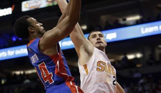 Detroit Pistons guard Ish Smith (14) drives past Phoenix Suns guard John Jenkins during the first quarter of an NBA basketball game, Wednesday, Nov. 9, 2016, in Phoenix. (AP Photo/Rick Scuteri)