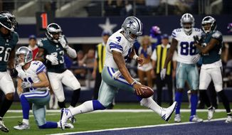 FILE - In this Sunday, Oct. 30, 2016, file photo, Dallas Cowboys quarterback Dak Prescott (4) runs the ball for a touchdown against the Philadelphia Eagles in the first half of an NFL football game in Arlington, Texas. Prescott, the seventh quarterback drafted this year, has won seven straight in Dallas, fitting well into the offense with help from fellow rookie running back Ezekiel Elliott. (AP Photo/Michael Ainsworth, File)