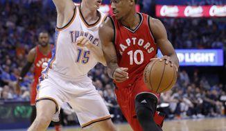 Oklahoma City Thunder forward Kyle Singler (15) defends as Toronto Raptors guard DeMar DeRozan (10) drives to the basket during the first half of an NBA basketball game in Oklahoma City, Wednesday, Nov. 9, 2016. (AP Photo/Alonzo Adams)