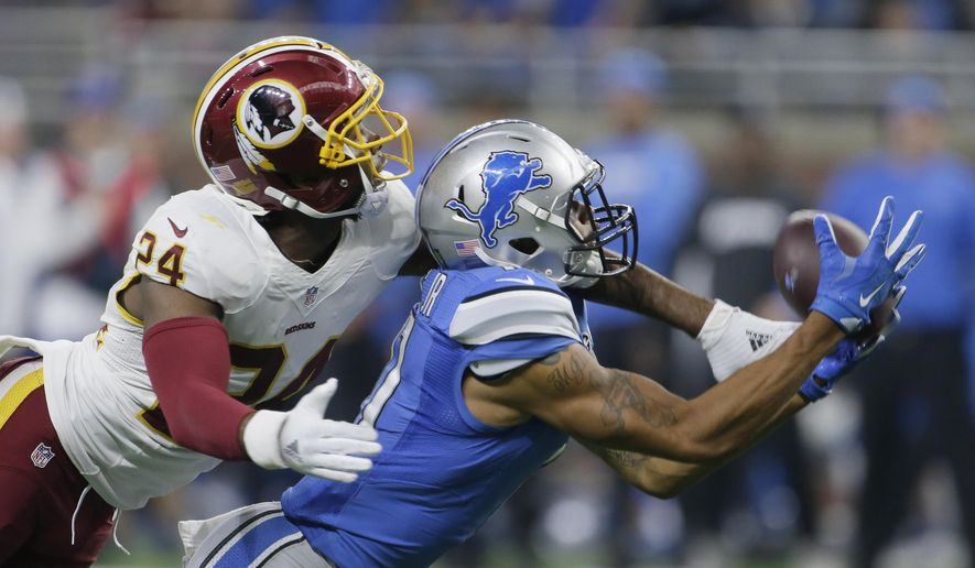 FILE - In this Oct. 23, 2016 file photo, Washington Redskins cornerback Josh Norman (24) covers Detroit Lions wide receiver Marvin Jones during the second half of an NFL football game in Detroit. To no one's surprise, Norman is sticking to his style, on and off the field. The Washington Redskins cornerback is not about to let the NFL's fines or officials' yellow flags deter him from doing what he does, whether it's speaking his mind about what he considers bad calls or sticking a hand in an opposing receiver's face. (AP Photo/Duane Burleson, File)